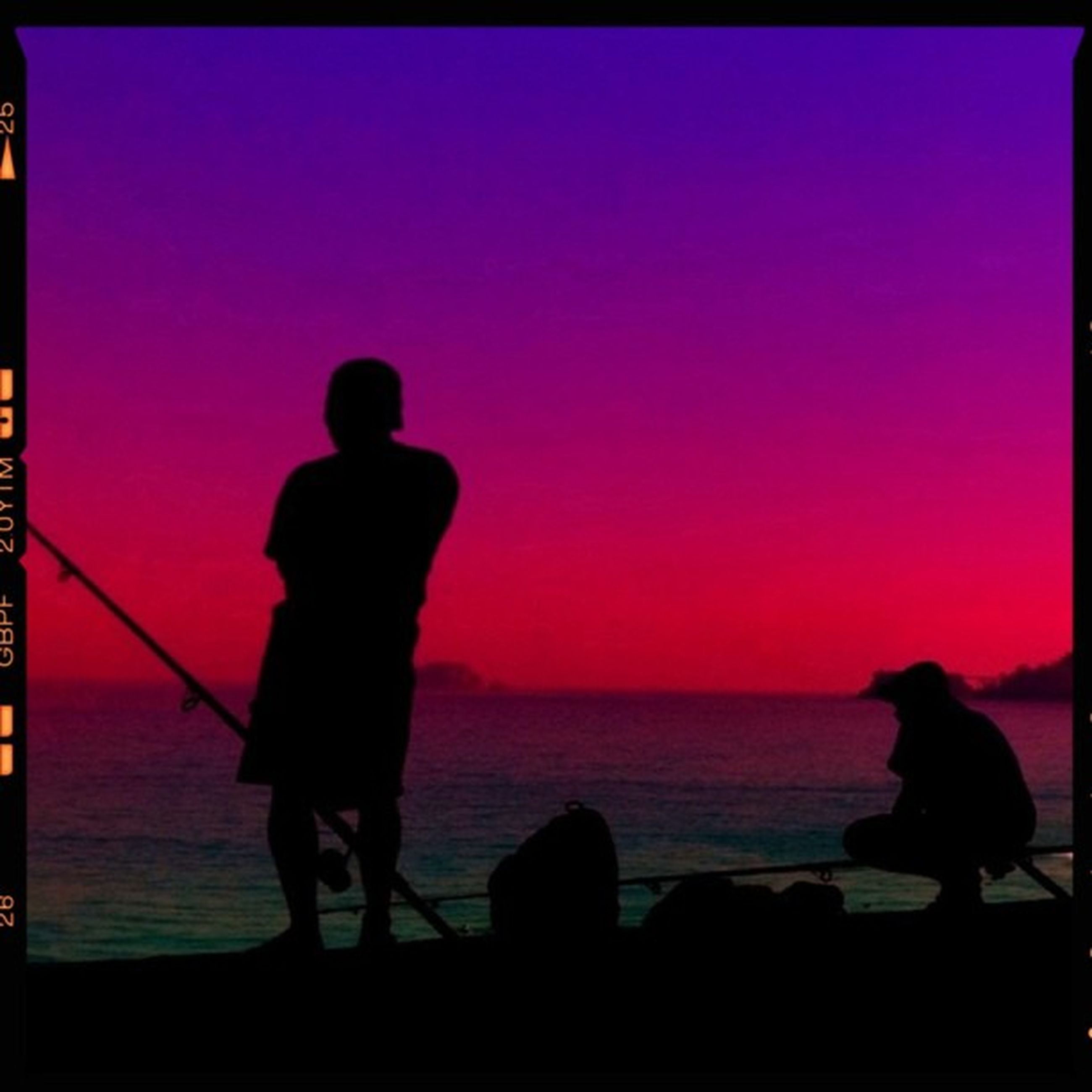 silhouette, sea, transfer print, rear view, standing, men, water, lifestyles, full length, horizon over water, leisure activity, auto post production filter, sunset, person, togetherness, copy space, clear sky