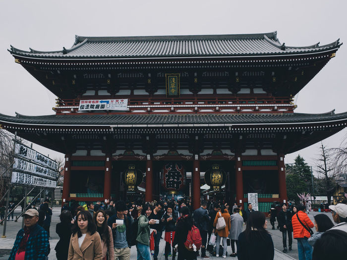 Group of people in temple outside building