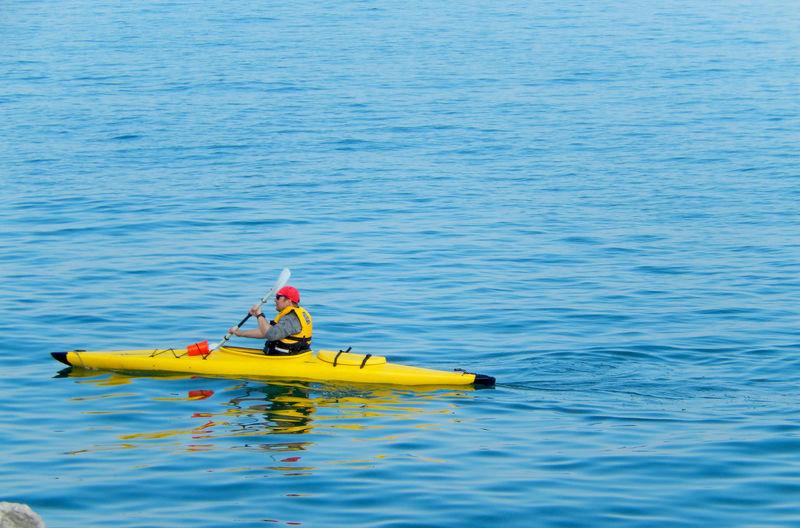 Balance Boat Burlington Canada Lake Lakeontario  Leisure Activity Man Recreational Pursuit Relaxing Sitting Sport Water Waterfront Weekend Activities Yellow Water Reflections Sports Kayak Kayaking Kayaks