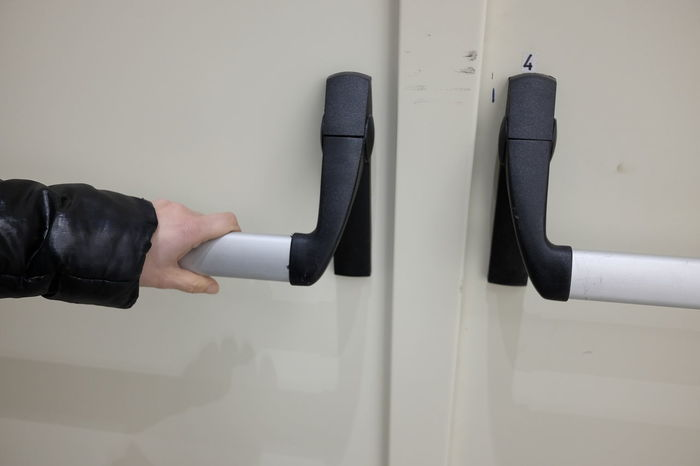 hands opening anti-panic door Emergency Freedom Panic Close-up Concept Day Device Door Emergency Exit Escape Exit Human Body Part Human Hand Indoors  Low Section Men People Push Safety Symbol