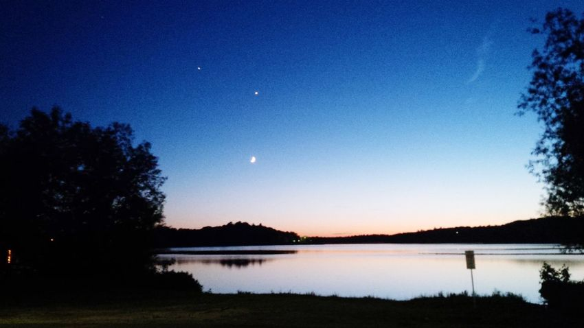Breath taking 💜 POV Of Dee Summertime Northern Ontario Sunset Moon Moonlight Calm Water Dusk Sunset Silhouettes