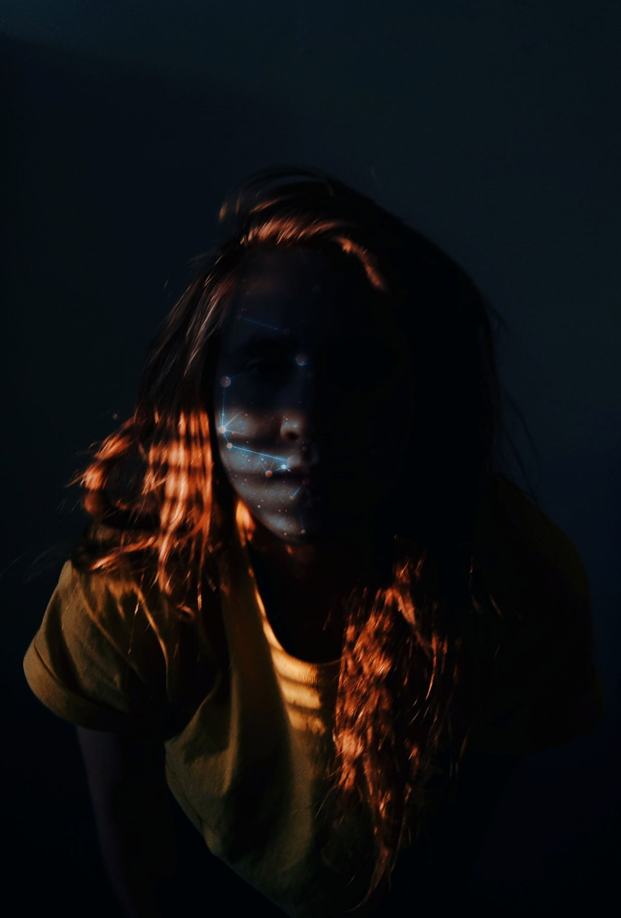 Portrait of young woman in darkroom