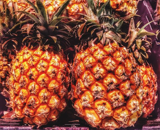 Juicy Pineapples Difficult To Prepare To Eat Fruit Galore Summer Time  Juicy To Eat Sharp Edges Green Stingy Leaves Orange Pineapple Food And Drink No People Food Close-up Orange Color Indoors  EyeEmNewHere Low Angle View Healthy Eating Freshness Fruit Full Frame Wellbeing Glowing