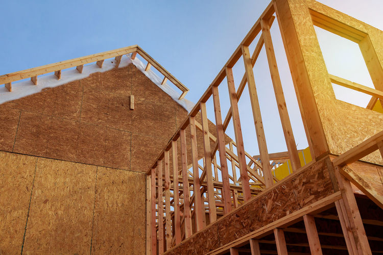 New construction residential home interior view New Home Construction Framed with Wood Studs Construction Construction Equipment Framing Home Industrial Renovation Roof Under Unfinished Work... Architecture Beams Build Building Built Structure Dwelling Frame Framework House House Construction Housing Lumber Plywood Reconstruction Residence Residential Building