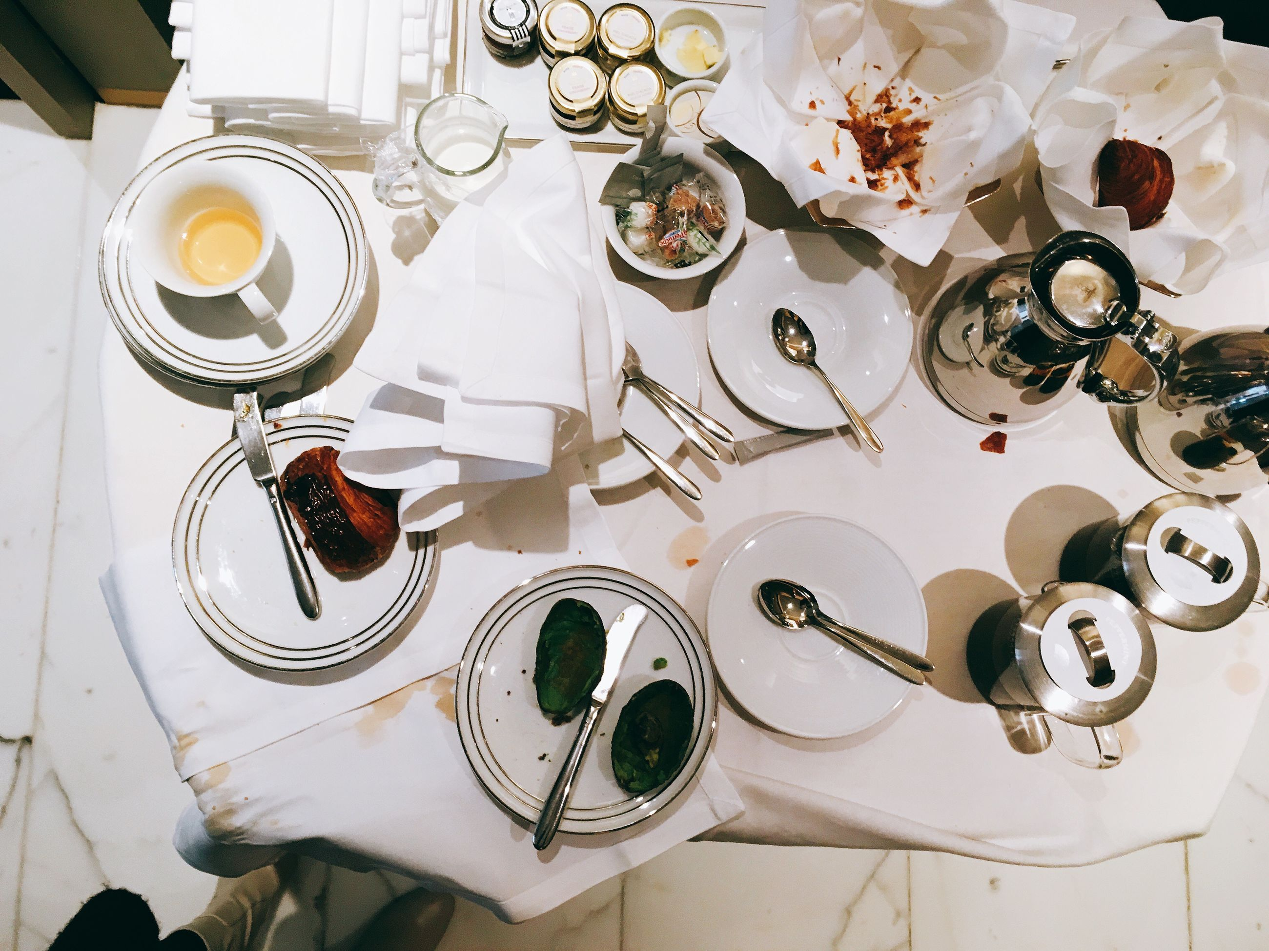 table, high angle view, plate, still life, indoors, place setting, large group of objects, no people, drinking glass, food and drink, fork, wineglass, food, dining table, celebration, setting the table, tablecloth, freshness, day