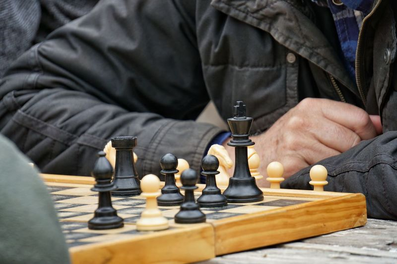 Midsection of man playing chess