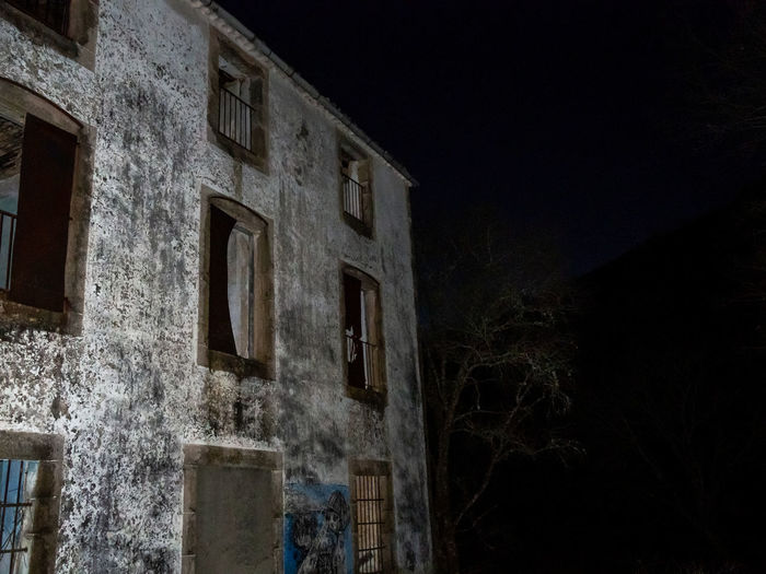 Low angle view of old building against sky at night