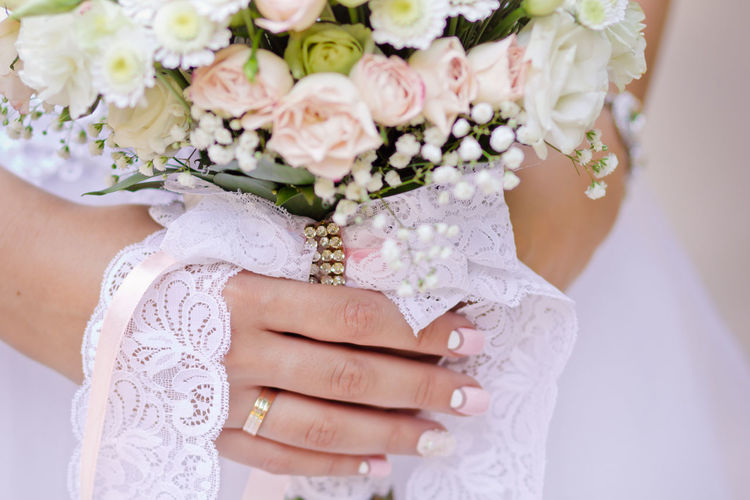 Bouquet Bride Celebration Celebration Event Ceremony Close Up Freshness Happiness Holding Human Body Part Human Hand Life Events Wedding Wedding Ceremony Wedding Dress Wedding Ring Wedding Ring Photography Women Women Hand