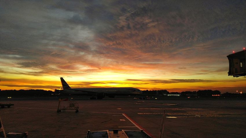 Silhouette. Sunset Cloud - Sky Orange Color Dramatic Sky Sky Outdoors Beauty In Nature Working Hard Hustle LGV10 Red Orange Yellow Sky Airport Cloudsandsky Lgv10photography