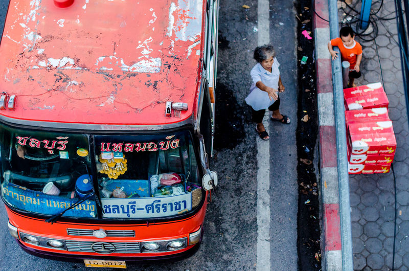 Vintage local bus with senior ticket taker Bus Chon Buri Land Vehicle Lifestyles Local Bus Mode Of Transport Old Old Woman Omnibus Passenger Car Real People Road Senior Street Street Photography Text Text Thailand Ticket Taker Top Views Transport Transportation Vintage Wellcome Women