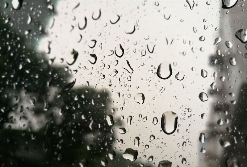Drop Window Wet Glass - Material Water Rain RainDrop Indoors  Rainy Season Weather No People Close-up Condensation Full Frame Backgrounds Day Freshness Nature Sky