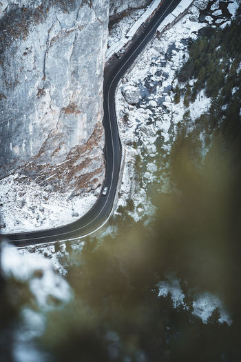 Aerial view of road amidst snow covered land