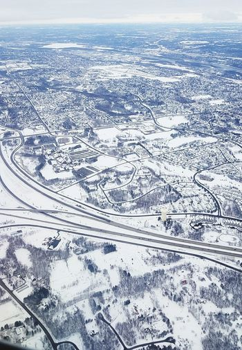 Winter Heartland Minneapolis St. Paul Minnesota Farms Airplane View Dismal Snowy Landscape Aerial View Snow Above Cold Temperature Blue