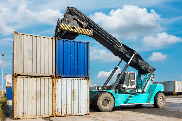 Crane Lifting Cargo Container At Dock