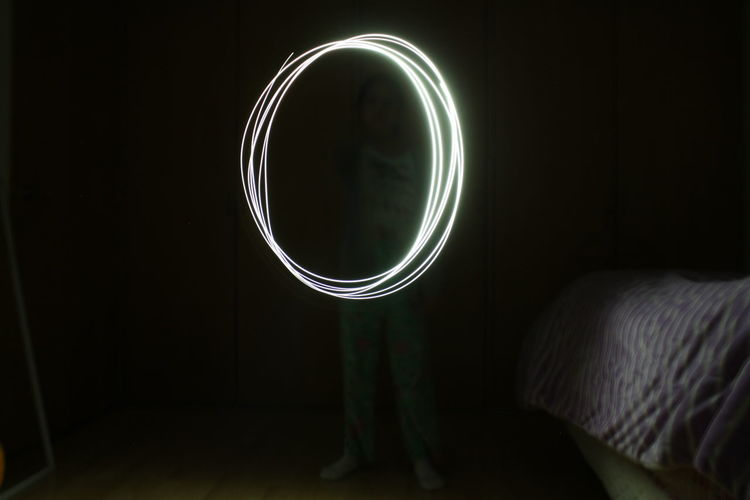 Illuminated Light Circle Light Painting Photography. Light Shot Long Exposure Night Performance Standing
