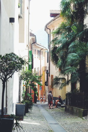 Alley Architecture Building Building Exterior Built Structure City City Life Day Diminishing Perspective Empty Footpath Growth Locarno Narrow No People Outdoors Plant Residential Building Residential District Residential Structure The Way Forward Tree Walkway Locarno, Switzerland Hidden Gems