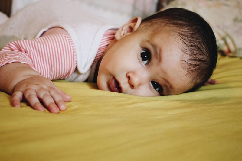 Baby Indoors  Innocence Bed Lying Down Portrait Looking At Camera One Person Babyhood Real People Lying On Back Domestic Life Close-up Cute Home Interior Bedroom Newborn Childhood Lifestyles Headshot Inner Power Visual Creativity