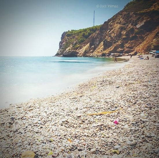Tamrabet Beach Tétouan -Morocco Beach Sea Text Water Outdoors Nature Sand Horizon Over Water Day Scenics Summer Travel Destinations No People Vacations Clear Sky Beauty In Nature