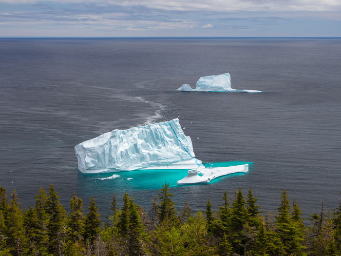 Iceberg on Atlantic ocean near St. John's, Newfoundland, Canada Iceberg Iceberg - Ice Formation Newfoundland Sunny Day St. John's Scenics - Nature Sea Water Beauty In Nature Nature No People Outdoors Ice Sky Cold Temperature Glacier Tranquility Frozen Tranquil Scene Day Environment Horizon Over Water Floating On Water