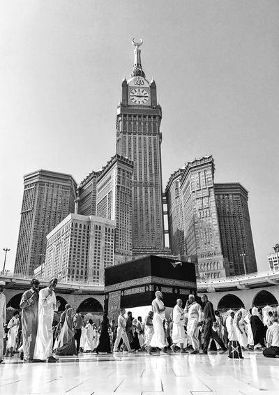 Architecture Large Group Of People Built Structure Building Exterior Modern Skyscraper Statue Sculpture Travel Destinations Men Real People Clear Sky Outdoors Day Sky Women City People pilgrims islam god muslim bless EyeEmNewHere Connected By Travel Black And White Friday