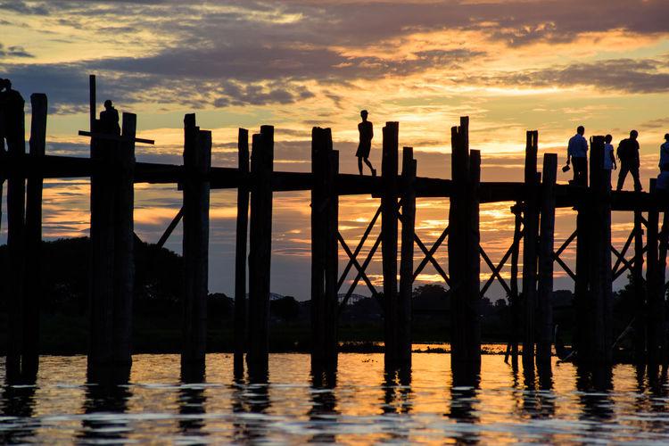 Silhouette bridge during sunset