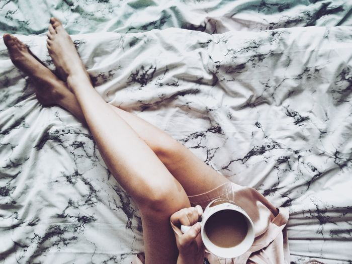 EyeEm Selects Human Hand Low Section Bedroom Women Drink Bed Young Women Relaxation Human Leg Sheet Black Coffee Personal Perspective Legs Crossed At Ankle