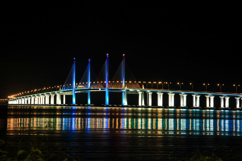 Illuminated Colorful Penang Bridge Over Strait Of Malacca Against Clear Sky At Dusk Georgetown Georgetown Penang Penang Penang Island Georgetown Penang Cafe Penang Bridge Penang Malaysia Penangisland