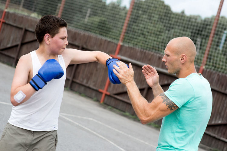 Adult Adults Only Boxing - Sport Challenge Competition Competitive Sport Day Exercise Equipment Exercising Healthy Lifestyle Lifestyles Men Only Men Outdoors Real People Senior Men Sport Sports Clothing Sportsman Standing Teamwork Togetherness Two People Young Adult Young Men