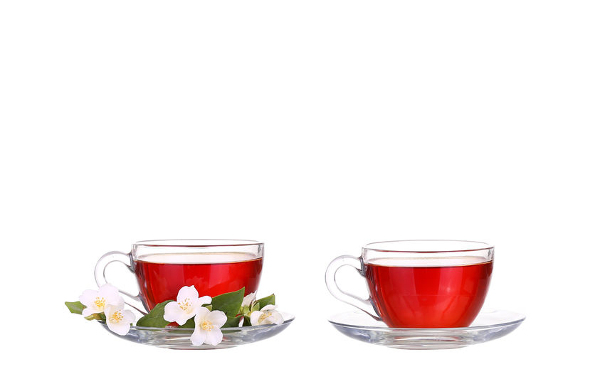 Glass of tea cup against white background