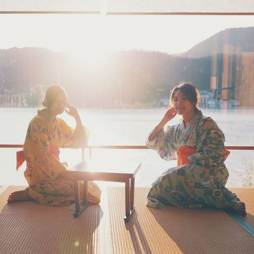 Japan Photography Adult Day Full Length Kimono Leisure Activity Lens Flare Lifestyles Mountain Nature Outdoors People Real People Relaxation Sitting Sunlight Togetherness Two People Window Women Young Adult Young Men Young Women