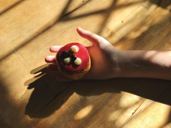 Human Hand Hanukkah Dounuts מייפוד מייחנוכה מייאייפון7 Food And Drink Food Holding High Angle View Human Body Part Human Finger Wood - Material Indoors  Healthy Eating Freshness Lifestyles Women Table Fruit Close-up Chopping Board Day Food Stories