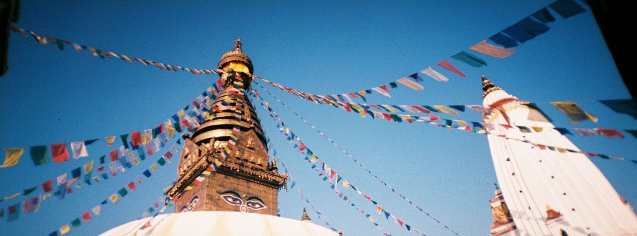 Low Angle View Of Swayambhunath Temple Against Clear Blue Sky
