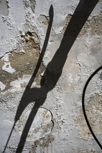 EyeEmNewHere Abstract Day Focus On Shadow High Angle View Light And Shadow Nature No People Outdoors Shadow Shadow Of A Bicycle Handle Sunlight