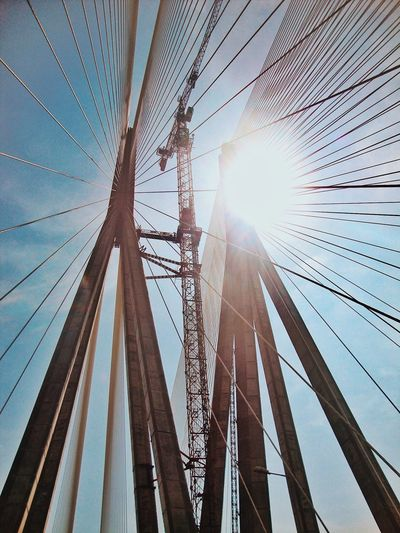Architecture Built Structure Cable Day Electricity  Electricity Pylon Lens Flare Low Angle View Mast Nature No People Outdoors Power Line  Power Supply Sky Sun Sunbeam Sunlight Stories From The City