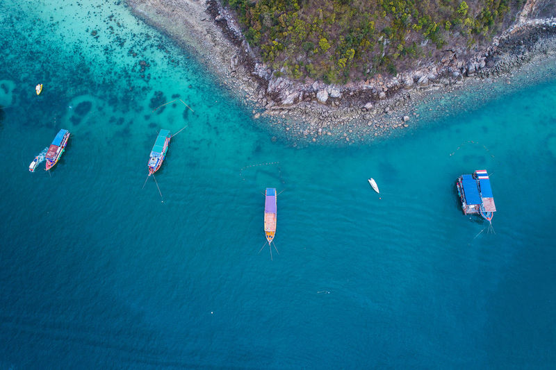Aerial view of boats moored sea