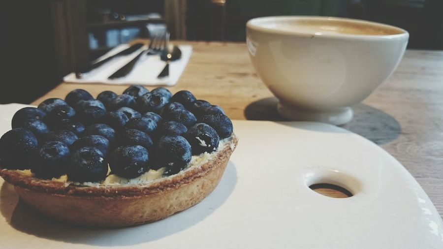 Close-Up Of Blueberry Tart On Cutting Board