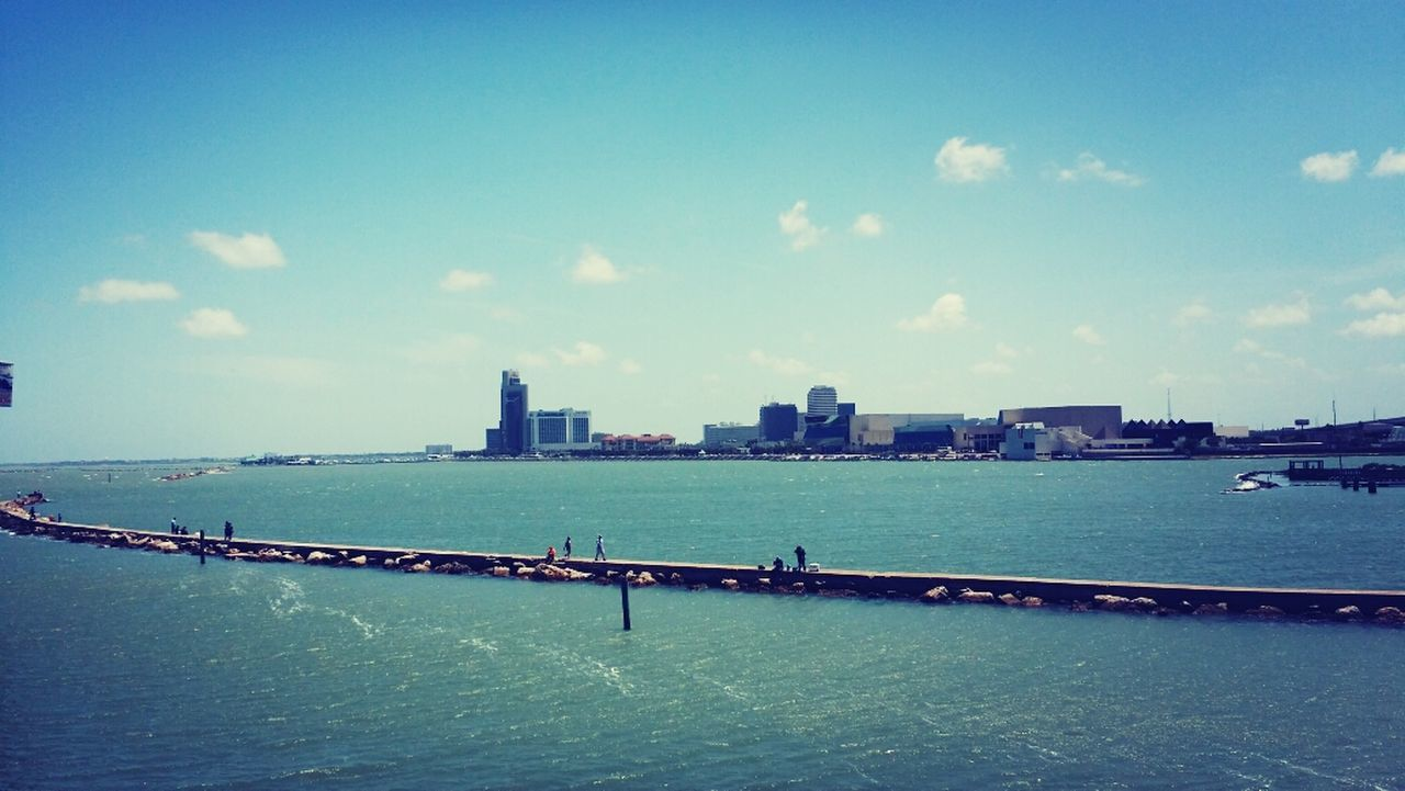 architecture, built structure, sky, building exterior, city, water, cloud - sky, day, outdoors, skyscraper, waterfront, cityscape, nautical vessel, sea, urban skyline, no people, nature