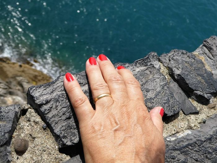 Just life Natural Art  EyeEm Gallery High Angle View @Mimmi236 Outdoors Close-up Human Body Part Nail Polish Sea Personal Perspective Red One Woman Only Vacations Leisure Activity Stony Ground Place Of Heart Sommergefühle Second Acts Travel Traveling Hand Hand Of A Woman An Eye For Travel