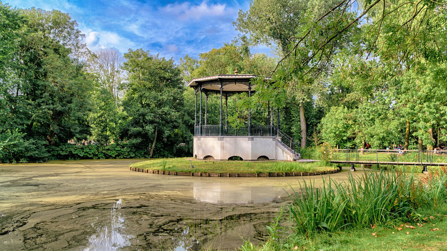 Small lake in Vondelpark, the largest and most popular park in the city of Amsterdam, Netherlands Architecture Beauty In Nature Day Fountain Growth Nature No People Outdoors Reservoir Scenics Sky Tree Water