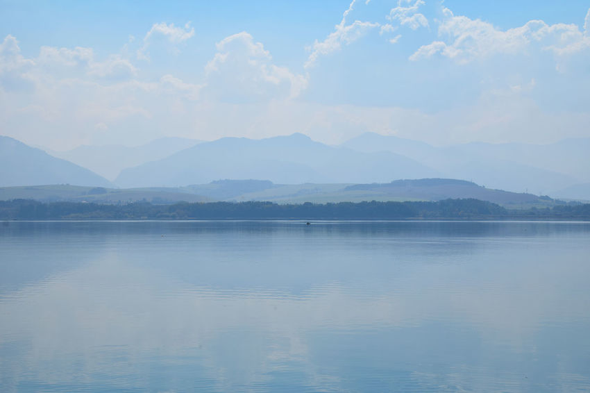 Waterfront panorama at Liptovska Mara lake Copy Space Destruction Liptovska Mara LiptovskáMara Travel Weather Beauty In Nature Blue Day Foggy Lake Mist Mountain Mountain Range Nature No People Outdoors Reflection Scenics Sky Tranquil Scene Tranquility Water Waterfront