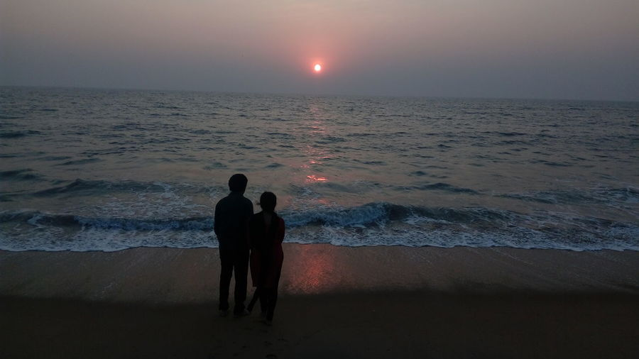 two people watching sunset , while I was taking pictures of sunset .... 😂😂😂😂 Light And Shadow The Purist (no Edit, No Filter) Enchanting India Simple Quiet Love ASIA Water Reflections Low Light Color Of Life Togetherness Sealife EyeEm Selects Focus On Foreground People Of EyeEm Check This Out Thoughts Photography Sea Two People Beach Silhouette Water Night People Horizon Over Water Sand Full Length Sunset Wave Outdoors Landscape