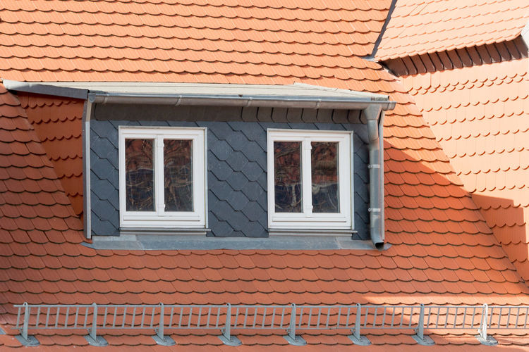 Roof facade with red roof tiles and loft conversion