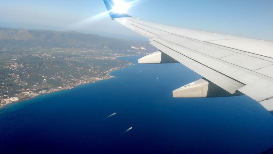 Aerial View Air Vehicle Aircraft Wing Airplane Airplane Wing Beauty In Nature Blue Close-up Day Flying Greece Journey Landscape Mid-air Mode Of Transport Mountain Nature No People Outdoors Scenics Sky Transportation Travel Vehicle Part View Into Land Water