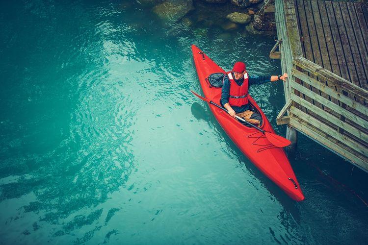 High angle view of man sitting in kayak on lake
