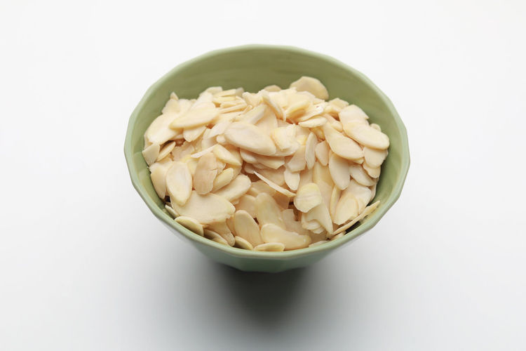 High angle view of pasta in bowl against white background