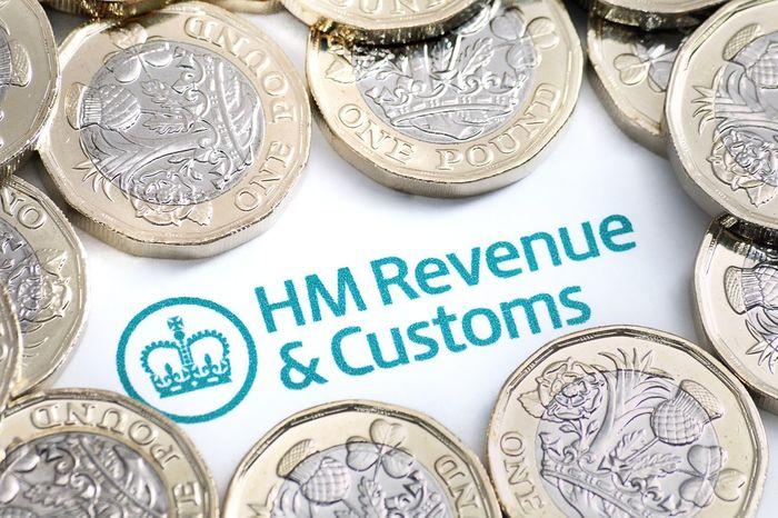 Close-up Finances Hm Revenue & Customs HMRC Money Money Money New Pound Coin Pounds Self Assesment Small Business Management Sterling Taxi Taxman Vatican