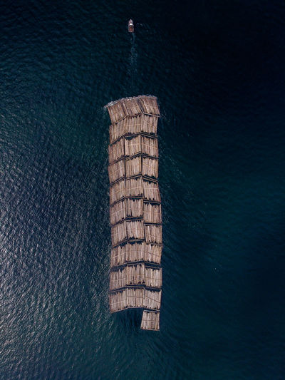 Aerial view of wooden raft in sea