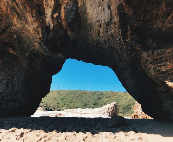 Rock Formation Rock - Object Geology Natural Arch Nature Beauty In Nature Physical Geography Sunlight Tranquility Day Scenics Arch Tranquil Scene Travel Destinations No People Cave Outdoors Arid Climate Landscape Sky Beach
