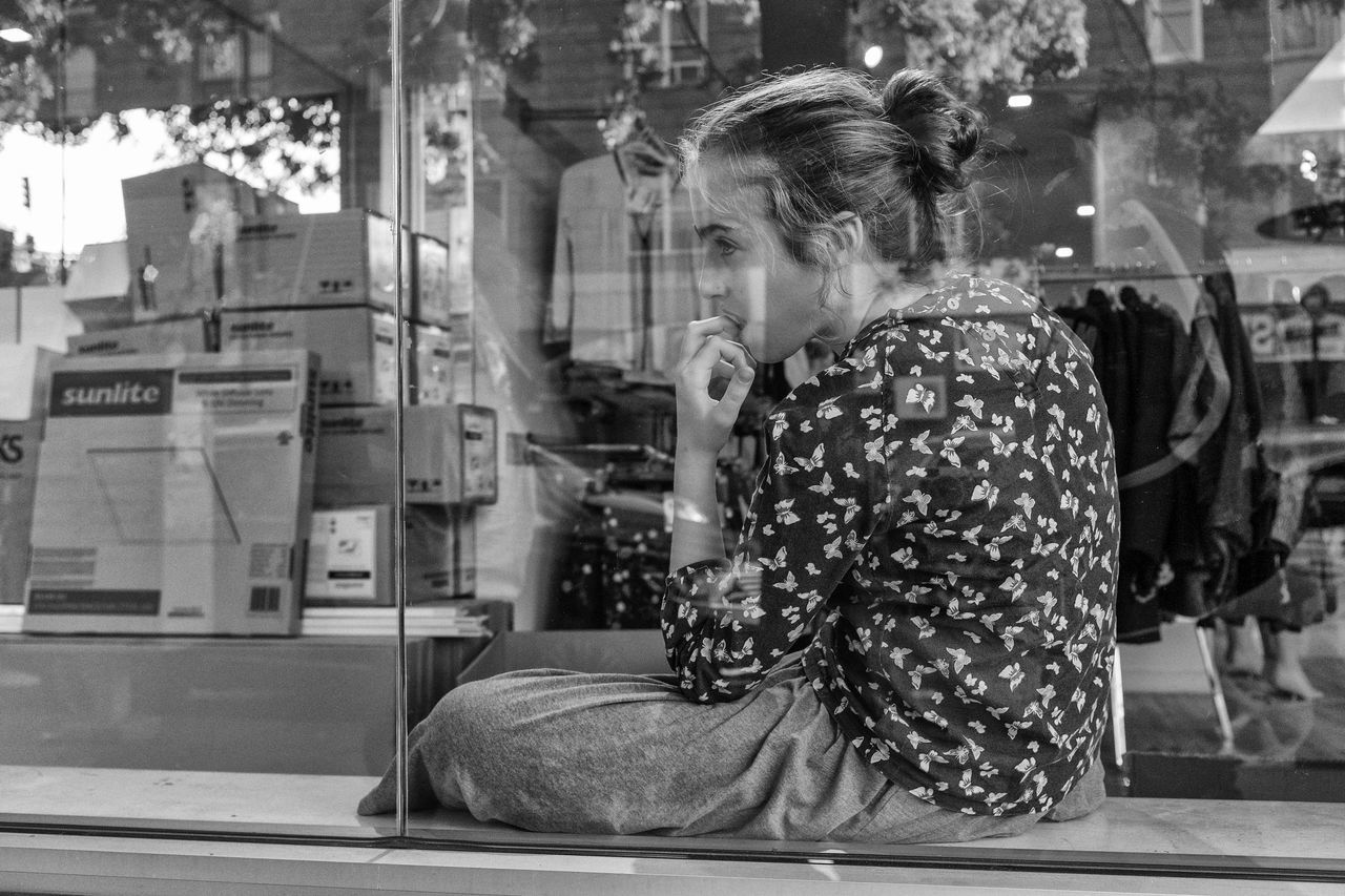one person, real people, sitting, casual clothing, reflection