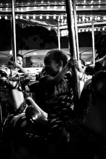 Horse riding. Amusement Park Arts Culture And Entertainment Amusement Park Ride Carousel Carousel Horses Indoors  Day Bnw_friday_eyeemchallenge Portrait Bnw_collection Streetphotography Bnwphotography Bnw_society Bnw_life Street Bnw_friday_challenge Bnw Photography Bnw_shot People Illuminated Night Indoors  Hanging Childhood Child Second Acts Black And White Friday EyeEmNewHere Business Stories